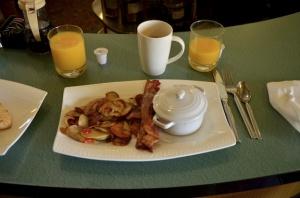 Sherried black truffle eggs, herb cafe potatoes, Nueske's bacon.
