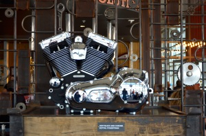 Graceful as sculpture, motorcycle drive trains are displayed in the dining area.