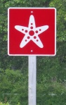 Acadian coastal scenic route sign.